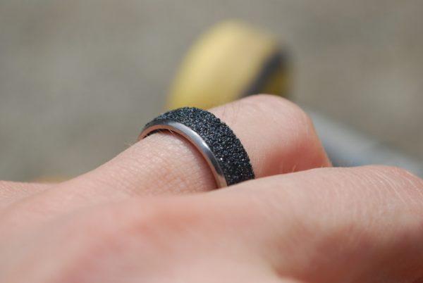 broken skateboard, jewelry, recycled materials